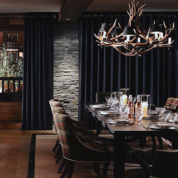 The table is set for fine dining in a luxury chalet