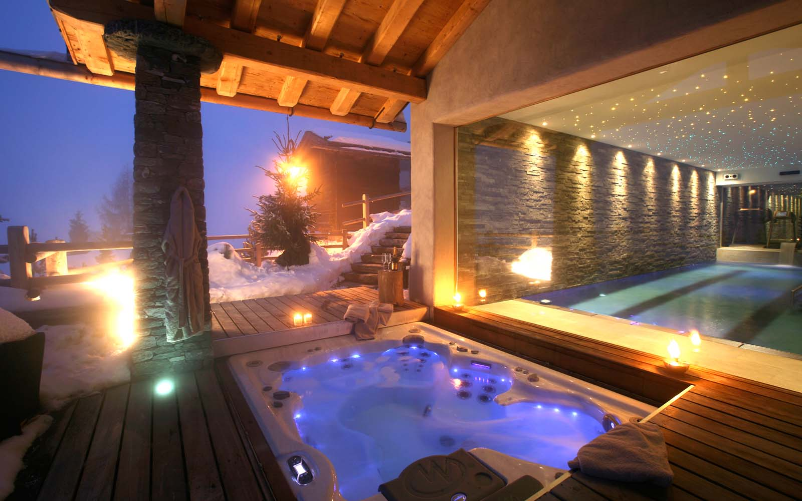 Chalet spa verbier in verbier by skiboutique for Jacuzzi enterre exterieur